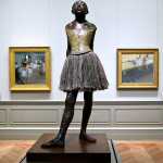 Edgar Degas. Small Dancer Aged 14. Cast in 1922, sculpture modeled c. 1879–80. Bronze partly tinted, tulle tutu, pink satin ribbon in the hair, wooden base. Orsay Museum, Paris